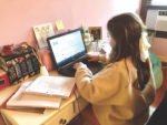 With social distancing decree, families begin work-from-home, homeschooling juggling act